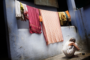 Vrindavan, India, 2009 - A daily life scene in a government-run safe home for widows. Although the local administration provides for the pension, accommodation and food to which destitute widows are entitled, very few of them can take advantage of these, and living conditions still remain difficult for most.  © Massimiliano Clausi/POSSE Photographers