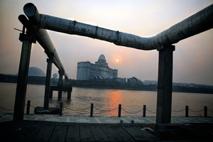The Youngor textiles factory compound on the banks of the Fenghua river in Ningbo shrouded in smog at dawn. In 2011 the waste-water was dumped directly into the location pictured above. ©Souvid Datta
