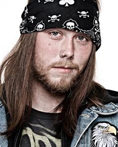 "David N., snowboarder, biker. From the Series ""Everyone My Brother Knows in Girdwood, Alaska"" © Laura Domela"