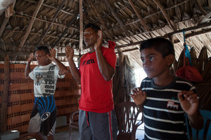Eduardo, Zé Brito e Manuel Brito during the mass in the community shack of the village. Every weekend a few members of the community get together for the Sunday prayer. © Eduardo Leal/4SEE