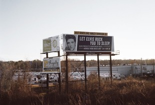 "Billboard, Elvis Presley Boulevard, Memphis. I had to follow them. To Graceland, Beale Street, Sun Studios, Elvis Presley Boulevard, I had to follow the fans.They come from all over the world and may save money for many years to see Memphis. Graceland is the most visited house in America after the White House. From the series ""Love me true"" © Clementine Schneiderman, IdeasTap finalist"