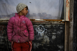 A Roma outside of a makeshift home in the Belville camp in New Belgrade. © Matt Lutton