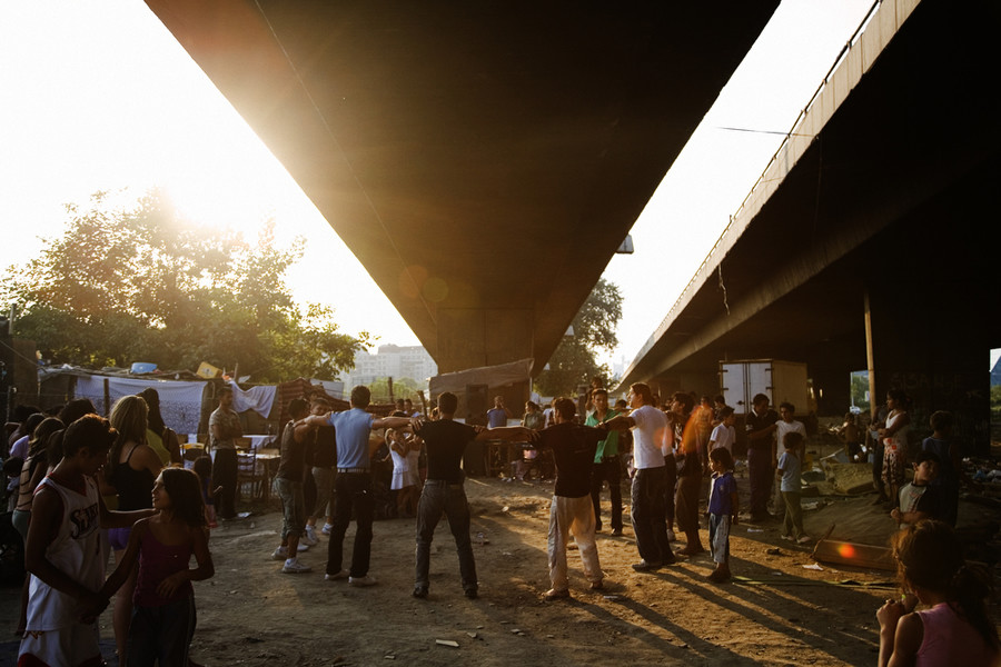 A late-summer party organized by a Roma family, refugees from Kosovo, under the Gazela bridge which flies over camps on both sides of the Sava river. The destruction of the camps is to make way for reconstruction of the old bridge. © Matt Lutton