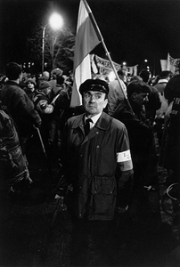 The newly recovered freedom of demonstration. A night gathering of WWII veterans that had suffered political prosecution, in front of the gates of the infamous political prison in Rakowiecka Street in Warsaw, a symbol of Communist oppression, 1989, from After-images of Poland © Witold Krassowski (Poland), from the exhibition Beyond Walls: Eastern Europe after 1989. Courtesy of the Noorderlicht Photofestival 2008.