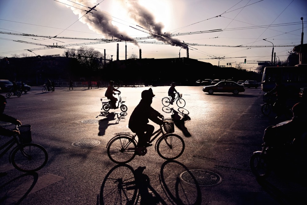 Morning on the 4th ring road of East Beijing. The 'smog apocalypse', caused by coal-fire power plants has become a notorious problem across China's urban areas. This January the cancer-causing PM2.5 fine particle pollution count reached 3 times the UN 'Extremely Hazardous' category, at over 900. © Souvid Datta