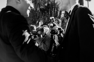 paparazzi clamour after a minor celebrity, 2014  © Alison McCauley