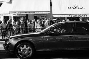a chauffeur waits in a queue of traffic heading towards the Palais des Festivals, 2014  © Alison McCauley