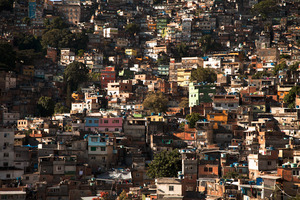 View of Rochina. Rochina is the largest slum in Brazil with over 200,000 residents but has only one main road where buses can transport people. The number of favelas, the 1,000+ hillside slums that surround Rio, has grown exponentially in the last few decades. In this area, the Rio police had to borrow massive armored vehicles from the Navy in order to enter the neighborhoods. © Manu Valcarce