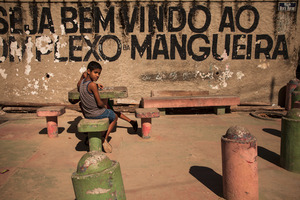Children play at the main entrance to Favela do Mangueira. Outside the neighborhood, the favela's youth are frequently confronted with social exclusion and limited employment prospects. This leaves them more suspectible to the lure of the drug trade. © Manu Valcarce