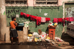 """Since October 2009, when the city won the right to host the 2016 Olympics, a host of construction projects have been unveiled across the city—museums, arenas, public works. The favelas, meanwhile, were sent """"Pacifying Police Units."""" © Manu Valcarce"""