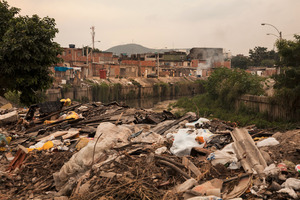 The main river that divides City of God. The favela, made famous by the movie of the same name, remains unchanged since the UPPs arrived in 2011. The police haven't even set foot east of the river, where the drug gangs remain too entrenched. © Manu Valcarce