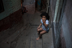 Although government officials describe the streets as dangerous, the sense of community remains strong among the locals. Children are often seen by themselves, unattended, at any time of the day. © Manu Valcarce