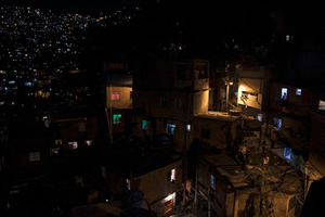 """A view of Rocinha at night. """"The process is only sustainable if you are capable of reducing poverty and inequality,"""" says Andre Urani, executive director of the Institute for Studies on Work in Rio. © Manu Valcarce"""