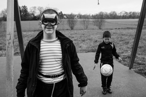 a mentally handicapped Kurdish boy from Turkey pretends to be Batman while a boy from Mongolia plays with a football  © Alison McCauley