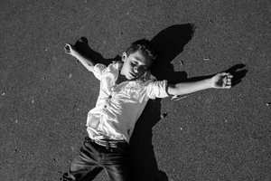 a Syrian boy pretends to be dead  © Alison McCauley