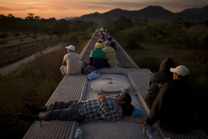 Central American migrants ride on top of freight trains through Mexico to reach the northern border, where they will attempt to cross into the United States. These migrants have increasingly become targets of drug cartels.  It is estimated that as many as 10,000 migrants were kidnapped in 2009. These kidnappings serve as an alternative source for the cartels. © David Rochkind