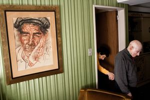 "1st prize Daily Life Stories: © Alejandro Kirchuk, Argentina. ""Never Let You Go"".  Marcos leads Monica from their room to the living room. Although at times he grumbles about the time devoted to her care, Marcos did not see any other possibility. Tell me where she is going to be better than here. I treat her like a princess, here she has everything."