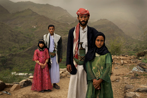 1st prize Contemporary Issues Stories: © Stephanie Sinclair, USA, VII Photo Agency for National Geographic magazine. Hajjah, Yemen, 10 June 2010 .  Tahani (in pink), who married her husband Majed when she was 6 and he was 25, poses for this portrait with former classmate Ghada, also a child bride, outside their mountain home in Hajjah. Nearly half of all women in Yemen were married as children.