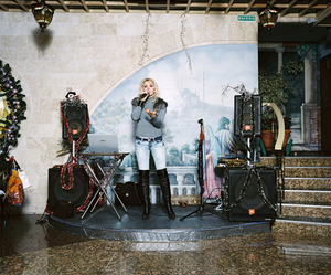 "1st prize Arts and Entertainment Stories © Rob Hornstra, The Netherlands. The Sochi Project: Sochi Singers. Marika Bajur sings ""Kuriu"" in the restaurant Eurasia. The southern Russian city of Sochi lies on the Black Sea and attracts predominantly Russian holidaymakers who come for a mix of sun, sea, sand and nightlife."