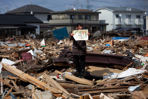 1st prize People in the News Stories: © Yasuyoshi Chiba, Japan, Agence France-Presse Aftermath of the tsunami, Japan, 3 April. Chieko Matsukawa shows her daughters graduation certificate as she finds it in the debris in Higashimatsushima city, Miyagi prefecture, Japan.