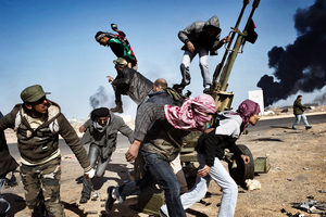 1st prize Spot News Singles: © Yuri Kozyrev, Russia, Noor Images for Time. Rebels in Ras Lanuf, Libya, 11 March.   For weeks, rebels held out against Libyan leader Muammar Gaddafi with the hope that the world would come to their aid. Defiance faded as the dictator's planes and tanks began to retake what had been dubbed Free Libya.