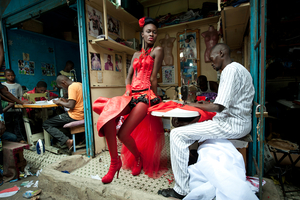 2nd prize Arts and Entertainment Singles: © Vincent Boisot, France, Riva Press for Le Figaro Magazine. Dakar, Senegal, 9 July.  A model poses in front of tailor stalls in the center of Dakar, Senegal. She wears the creation of a designer, Yolande Mancini, participating in the 9th edition of Dakar Fashion Week.