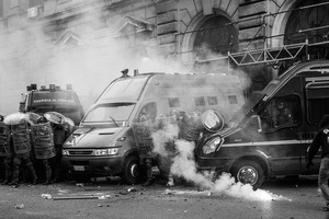 The entrance of the Ministry of Economy is being attacked by a group of rioters, some of whom threw crude homemade explosive devices and others who took part in acts of vandalism.  19 October 2013. © Riccardo Budini / UnFrame