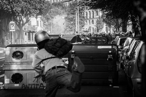 A rioter attacks  the riot police  during the urban guerilla triggered by 'black blocs' fringes.  15 October 2011. © Riccardo Budini / UnFrame