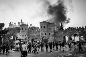 A dense cloud of black smoke is raised high after a Carabinieri (military police) truck is set on fire by outraged fringes of  rioters in the historic San Giovanni square.  15 October 2011. © Riccardo Budini / UnFrame