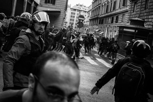 Panicked protesters escape a riot police storm as  the Ministry of Economy is been  attacked by a group of rioters, some of whom threw crude homemade explosive devices and others who took part in acts of vandalism.  19 October 2013. © Riccardo Budini / UnFrame