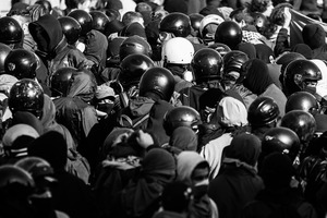 A group of 'black bloc' militants disguise themselves in the crowd during the national rally of 15 October   2011. © Riccardo Budini / UnFrame