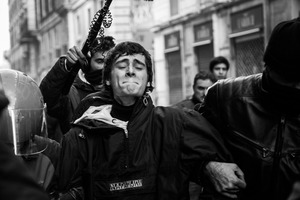 A young rioter is being arrested during the clashes sparked by the Senate and Lower House vote of confidence that resulted in a razor-thin victory for Berlusconi to continue his mandate.  14 December 2010. © Riccardo Budini / UnFrame