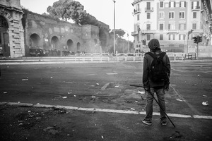 A rioter faces a police deployment  holding  a iron bar as seen during the long clashes that ravaged the historical San Giovanni square.   15 October 2011. © Riccardo Budini / UnFrame