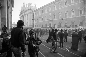 Frightened tourists flee the historical San Giovanni square as it is being ravaged by violent fringes of protesters.  15 October 2011. © Riccardo Budini / UnFrame