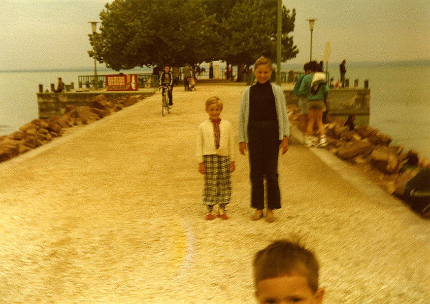 The photographer and his sister, posing for a picture on the waterfront of Lake Balaton, circa 1985. This snapshot is the only reminiscence of six subsequent summers spent by the lake. © Michal Solarski