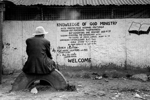 "© Tony Corocher - Disillusion…- Come to church and ""the knowledge of God Ministry"" will save you from desperation! Welcome to Mathare!!!When I saw this man I immediately pictured him as someone who had seen it all, someone who knew that with or without religion there is no easy way out… Complete, total poverty pushes men to believe, just in order to have a little hope. Right or wrong, it is still"
