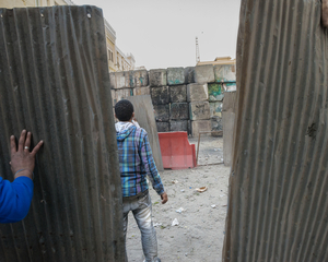 A five-meter-high wall that separates Tahrir Square from the more vibrant city center of economical and political power, was knocked down on the afternoon of 24 January, one day before the anniversary of the revolution, by protesters during a demonstration. The clashes lasted until the night, but by the next day, the wall had been already rebuilt. © Domenico D'Alessandro