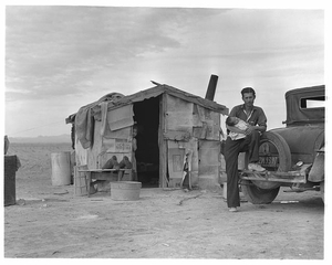 Migratory Mexican field worker's home on the edge of a frozen pea field. Imperial Valley, California © Dorothea Lange