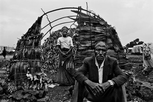 © Kate Geraghty (Australia) Godelive Ntamushobora, 45, with her husband Kadogu Sebishimbo, 60, in front of their half-finished makeshift home in the Kibati (IDP) Internally Displaced Persons' camp where tens of thousands of IDPs live, Democratic Republic of Congo. Honorable Mention, LensCulture Exposure Awards 2009