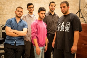 The members of The Ill Paz, a rap group, just before they're going on stage at a concert in Birzeit. All members of the group are students at Birzeit University but hope to be able to be able to make a living with their music one day . Their lyrics and music are political bracing all aspects of daily life under occupation. © David Brunetti