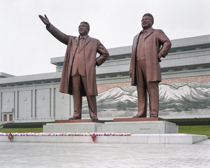 Mansudae Grand Monument with Kim Il Sung and Kim Jong Il's 20 meters tall statues in front of the sacred Mount Paektu's 70 meter long mosaic. © Maxime Delvaux