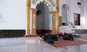 Meiktila, Myanmar, 2013. Muslims rest while they rebuild their Mosque after it was damaged in fighting. © Spike Johnson