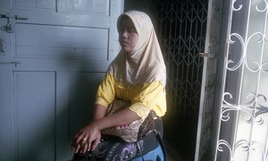 Yangon, Myanmar, 2013. A lady attending a secret support and education group for young Muslims. © Spike Johnson