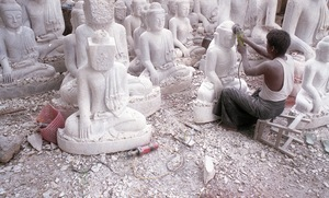 Mandalay, Myanmar, 2013. A sculptor puts the finishing touches to Buddha's face. © Spike Johnson