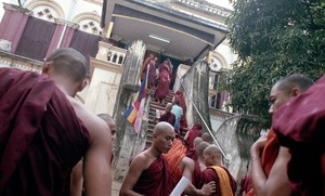 Mandalay, Myanmar, 2013. Wirathu's monks attend a 969 meeting, to discuss their proposed bill to ban interfaith marriage across the country. © Spike Johnson