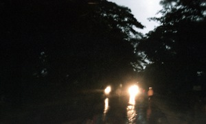 Meiktila, Myanmar, 2013. Cars pass on a monsoon road. © Spike Johnson