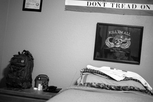 Dallas, Texas, 2010. The barrack style bedroom of a survivalist group member, complete with camouflage pillow and ready-to-grab survival bag. © Spike Johnson
