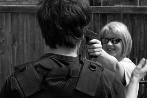 Dallas, Texas, 2011. The Texas Survivalists learn how to face a loaded weapon. Disarming her assailant with bare hands, Patricia turns his own pistol towards him. © Spike Johnson