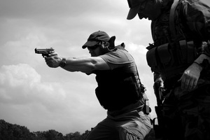 Dallas, Texas, 2011. The Texas Survivalists practice live fire drills. Throughout the day there are three accidental discharges. © Spike Johnson