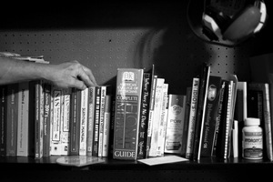 Dallas, Texas, 2010. A Texas Survivalist's library of survival books. © Spike Johnson